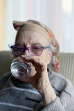 Senior woman drinking water Royalty Free Stock Photography
