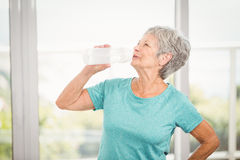 Senior woman drinking water Stock Photos
