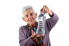 Senior woman drinking water on white background