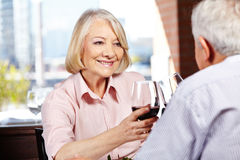 Senior woman drinking wine Royalty Free Stock Photos
