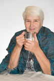 Senior woman drinks coffee Royalty Free Stock Images