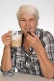 Senior woman drinks coffee Royalty Free Stock Photos