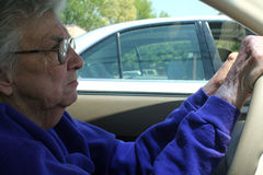 Senior Woman Driving Stock Photo
