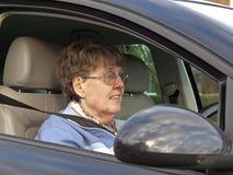 Senior Woman Driving. Mature female driving a car royalty free stock photos