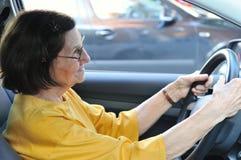 Senior woman driving car. Active senior woman - grandmother driving car, detail Stock Photos