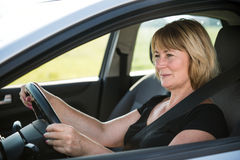 Senior woman driving car Stock Image