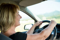 Senior woman driving car Royalty Free Stock Photo