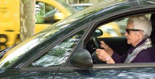 Senior woman driving a car. A senior woman driving a car Royalty Free Stock Photography