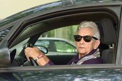 Senior woman driving a car. A senior woman driving a car Stock Photos