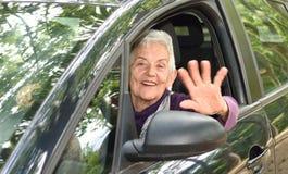 Senior woman driving a car. A senior woman driving a car Royalty Free Stock Image
