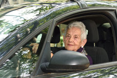 Senior woman driving a car. A senior woman driving a car Royalty Free Stock Photo