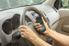 Senior woman driving car and calling mobile phone Stock Images