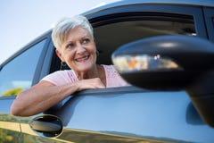 Senior woman driving a car. Happy senior woman driving a car Royalty Free Stock Photography