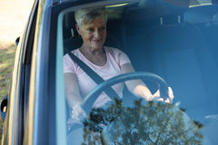 Senior woman driving a car. Happy senior woman driving a car Stock Photo
