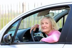 Senior woman driving the car Royalty Free Stock Photo