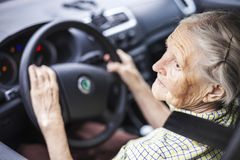 Senior woman driving a car Stock Images