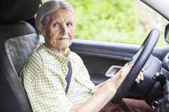Senior woman driving a car Royalty Free Stock Image