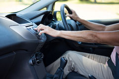 Senior woman driving a car. Mid-section of senior woman driving a car Royalty Free Stock Photos