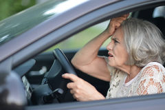 Senior woman driving car Stock Photos