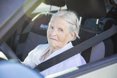 Senior woman driving car. On summer day Royalty Free Stock Image