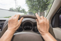 Senior woman driving a car in town Royalty Free Stock Photography