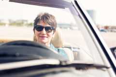 Senior Woman Driving A Convertible Classic Car Royalty Free Stock Images