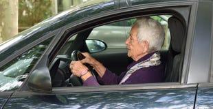Senior woman driving a car. Senior woman driving her car stock photo