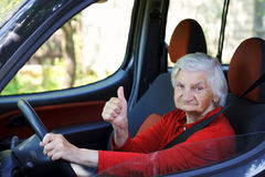 Senior woman driving Stock Photos