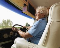 Senior woman driving RV. Royalty Free Stock Photos