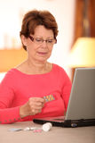 Senior woman and drugs Stock Photography