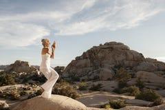 Free Senior Woman Eagle Pose Powerful Spirit Stone Stock Images - 149305484