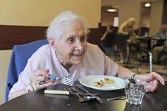 Senior woman eating stock image