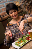 Senior woman eating. A healthy salad food, with glass of beer royalty free stock photo