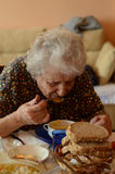 Senior woman eating. Her lunch at home Stock Photography