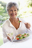 Senior Woman Eating An Al Fresco Lunch Stock Images