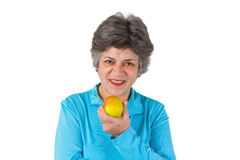 Senior woman eating apple Stock Photos