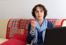 A senior woman eating an apple Stock Photography
