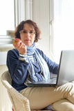 A senior woman eating an apple Stock Photos
