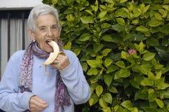 Senior woman eating banana Royalty Free Stock Image