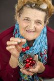 Senior woman eating cherries Royalty Free Stock Image