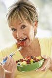 Senior Woman Eating Fresh Fruit Salad Royalty Free Stock Photo