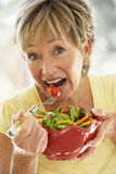Senior Woman Eating Fresh Fruit Salad Royalty Free Stock Images