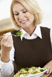 Senior Woman Eating A Healthy Meal Stock Photo