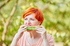 Senior woman eating a healthy watermelon Stock Photo