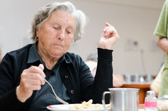 Senior woman. Eating her lunch Royalty Free Stock Photography
