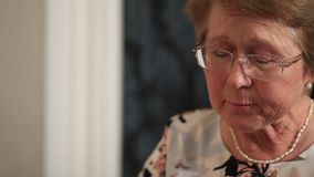Senior woman eating homemade food stock footage