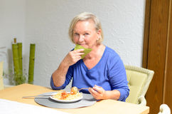 Senior woman eating a meal Royalty Free Stock Image