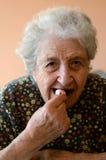 Senior woman eating. A senior woman eating something Stock Images