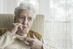 Senior woman eating something Stock Photos