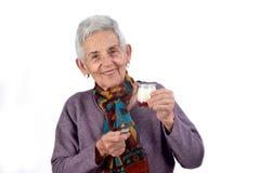 Senior woman eating yogurt on white background royalty free stock image